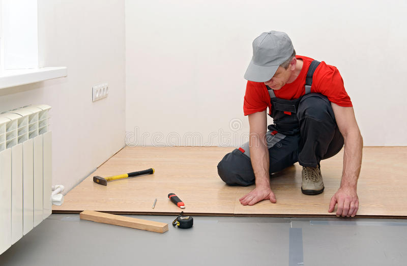 Installation of a laminate in the room stock images