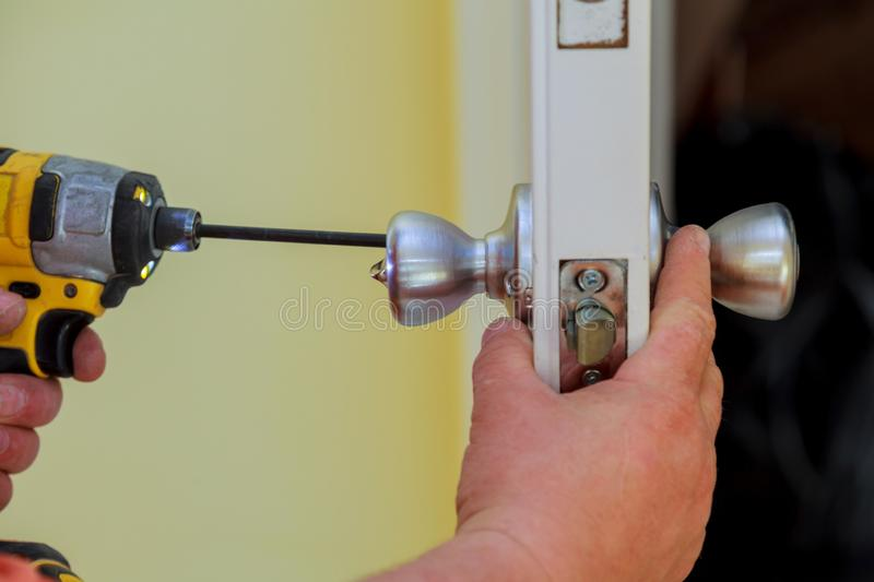 Installation locked interior door woodworker hands install lock royalty free stock image