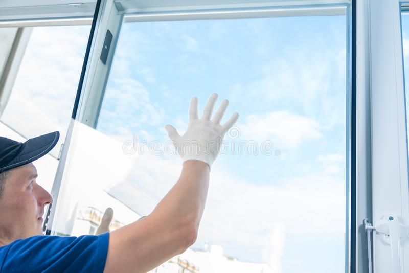 Installation of new plastic windows in the apartment in fine weather royalty free stock photos