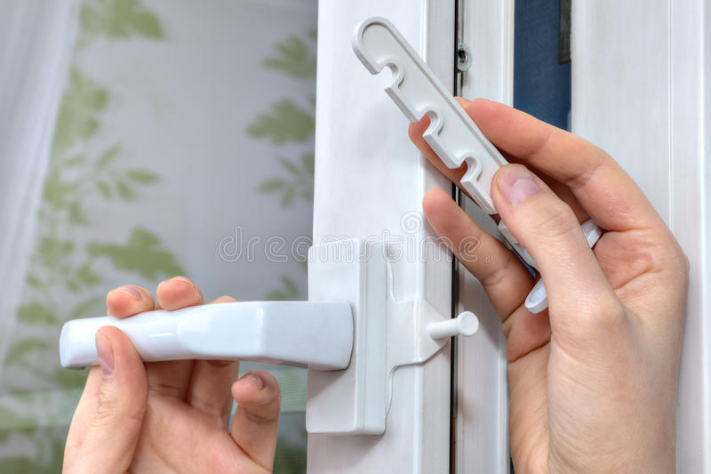Installation of opening limiter on the pvc window, close-up. royalty free stock photos