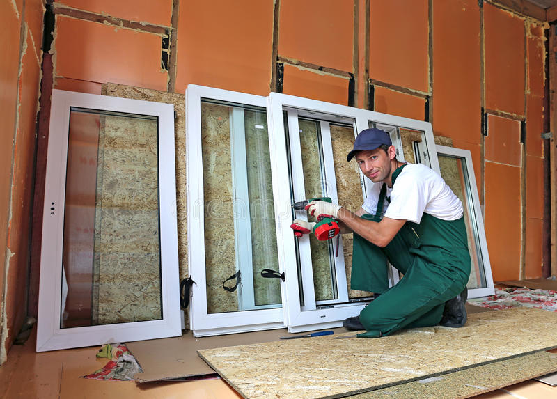 Installation of plastic windows stock photos