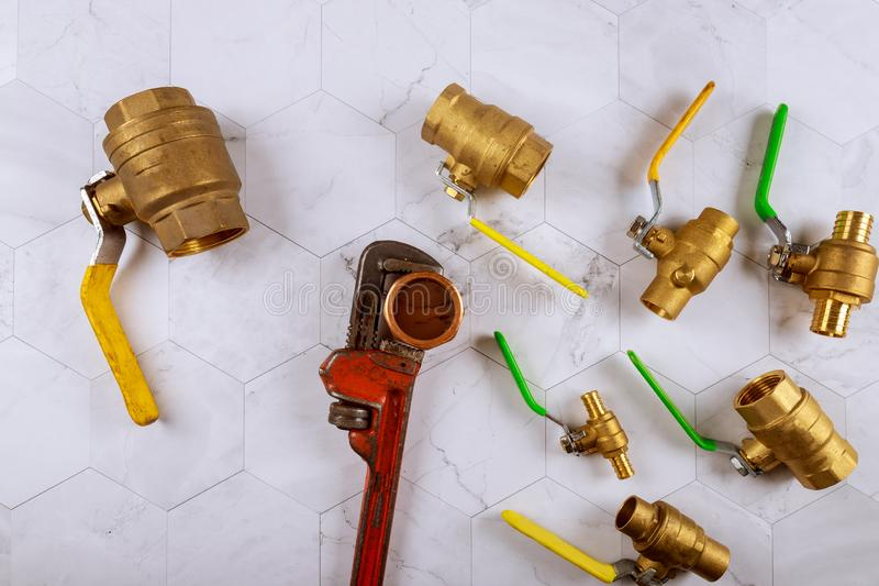 Installation plumbing parts monkey wrench construction brass plumbing fittings gate valve. On fitting tap, industrial, pipe, equipment, water, connection royalty free stock photo