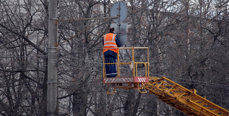 Installation of a road sign on a column on Volokolamskoye Highway. Roadwork. Moscow stock photos