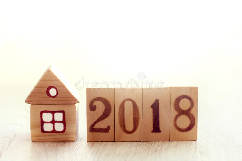 Personal eco-friendly property in 2018. Installation of small wooden house and fence with numbers royalty free stock photography