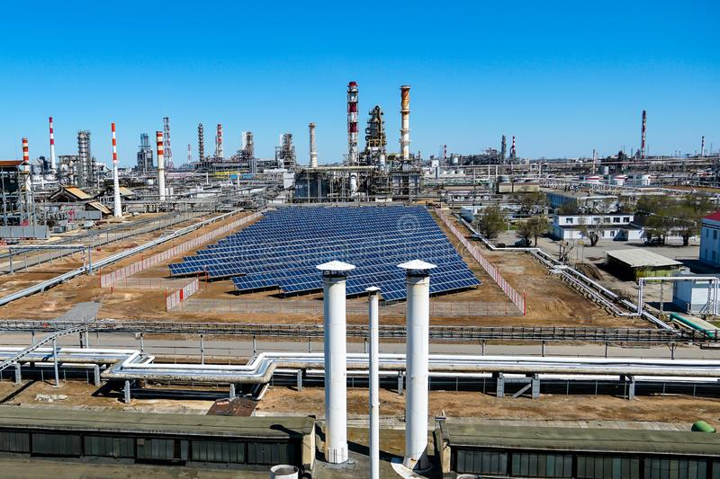 Installation of solar panels at and Oil refinery in Russia. equipment and complexes for hydrocarbon processing. Panorama of the oil refinery. Oil refinery in stock images