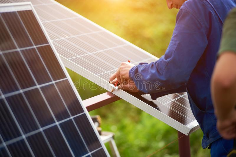Installation of stand-alone exterior photo voltaic panels system. Renewable green energy generation. Stand-alone exterior photo voltaic system installation royalty free stock images