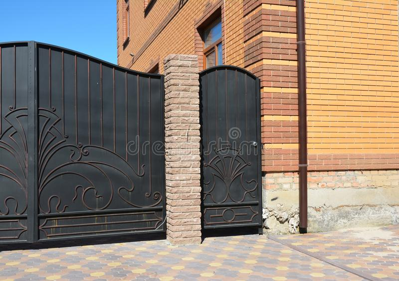 Great Metal Fence Door Installation. Installation Of Stone And Metal Fence With  Door And Gate.