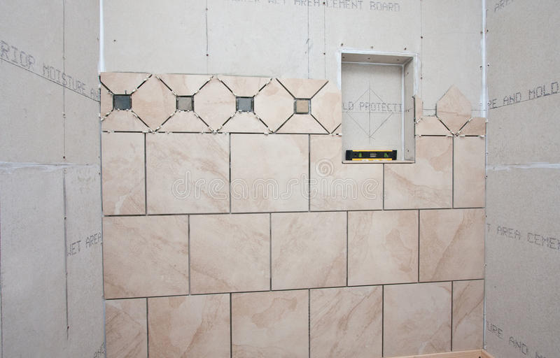 Installation Of Tiles In Bath Royalty Free Stock Photo