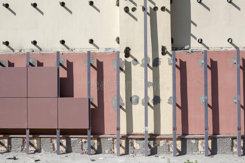 Installation of ventilated facades with tiles stock images