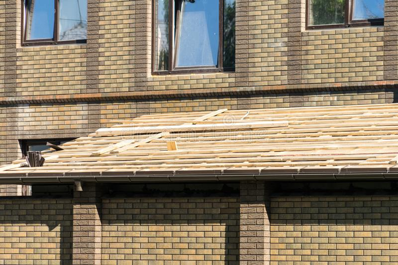 Installation of Windows in the roof when installing the roof stock images