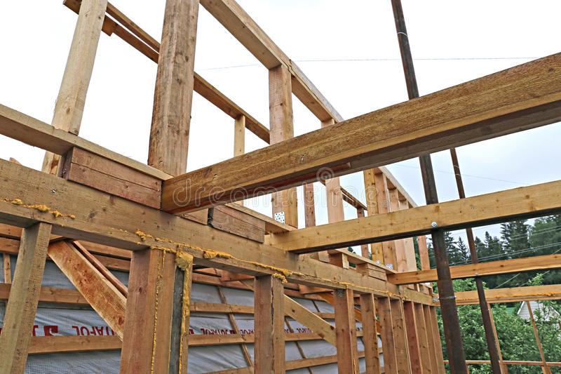 Installation of wooden beams at construction the roof for Wood roof truss prices