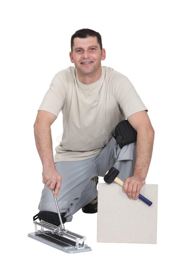 Installatore delle mattonelle fotografia stock