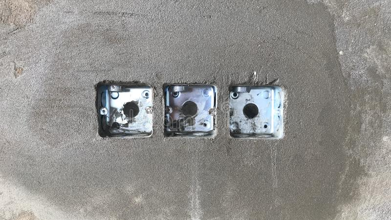 Installed the mk box in the concrete wall for the lighting system switch. In the fatory royalty free stock photo