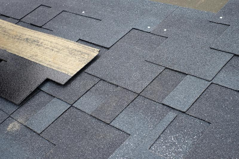 Installing asphalt roofing shingles. Installation of waterproofing coating in construction stock images
