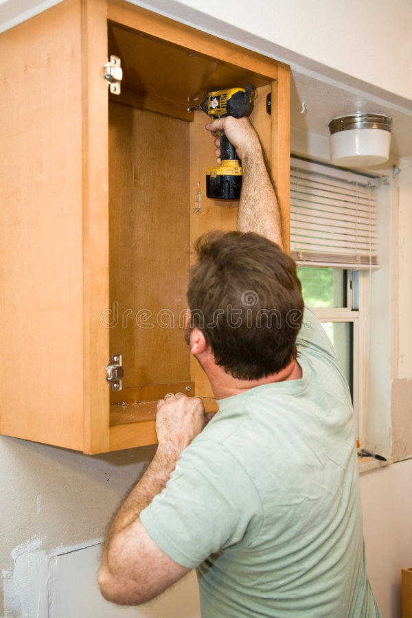Download Installing Cabinets stock image. Image of drill, careful - 6883541