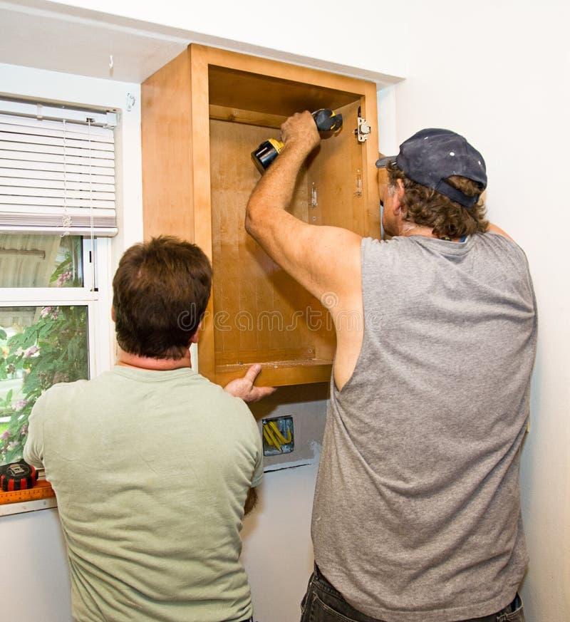 Download Installing Cabinets - Teamwork Stock Image - Image: 6883545