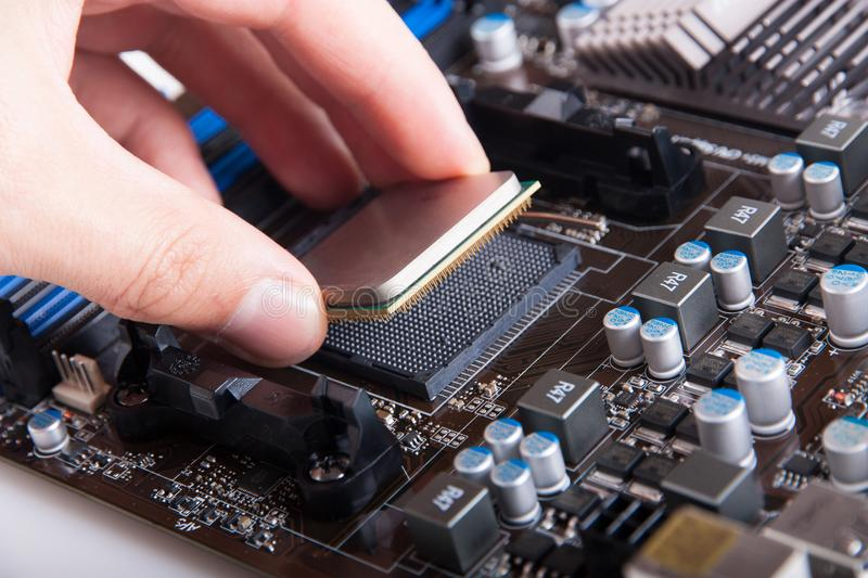 Installing central processor unit stock images