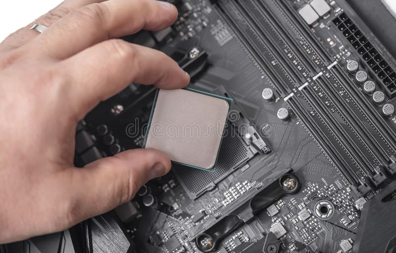 Installing processor unit into computer motherboard. stock images