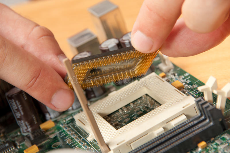 Installing computer processor stock image