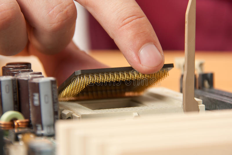 Installing computer processor stock photos