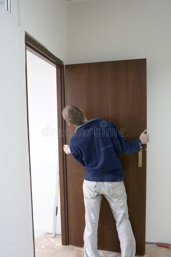 Installing the doors stock images