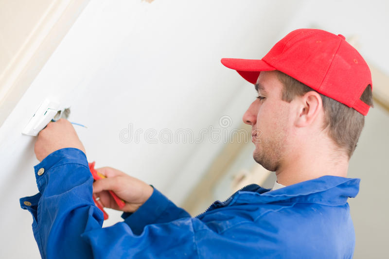 Installing an electrical plug / contact stock images
