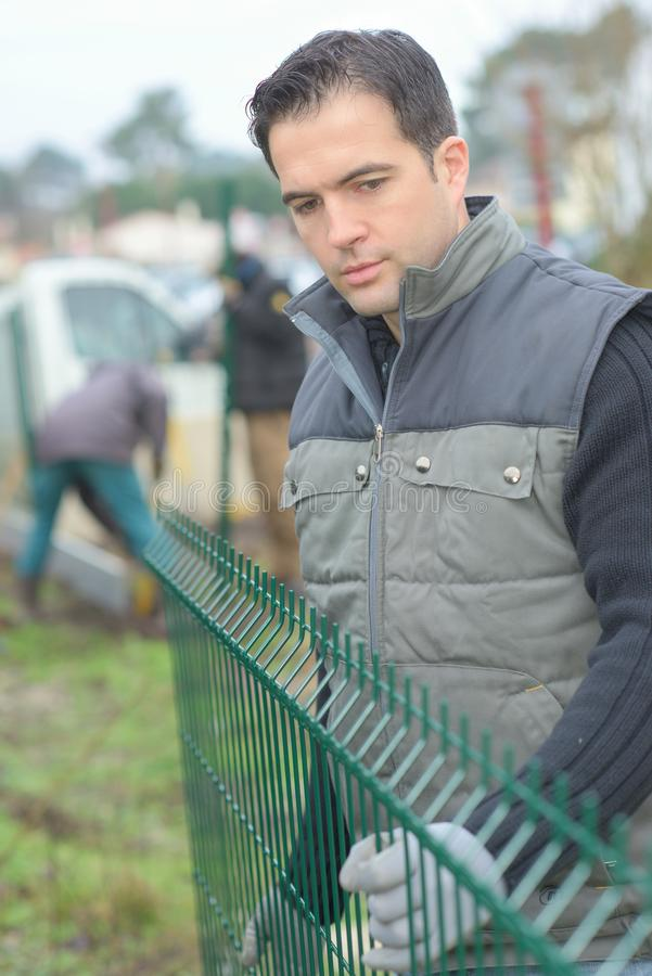 Installing a fence outdoors royalty free stock photos