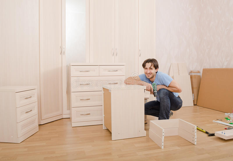 Installing furniture stock photography