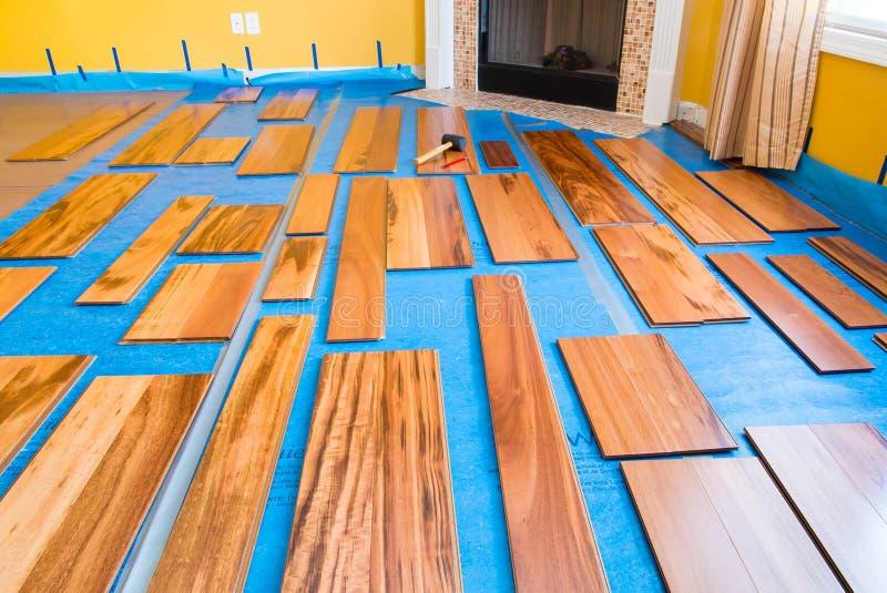 Installing hardwood floor. Preparation for installing planks of hardwood floor stock image