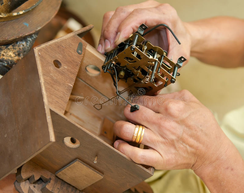 Installing the Heart of a Cuckoo Clock royalty free stock photo