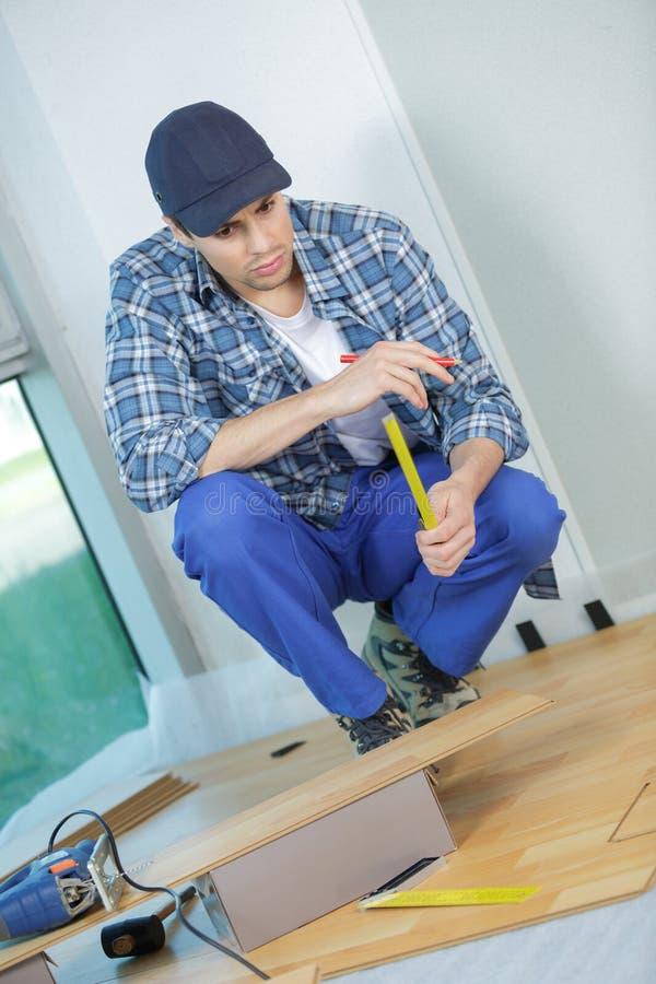 Installing laminate flooring fitting next piece stock photography