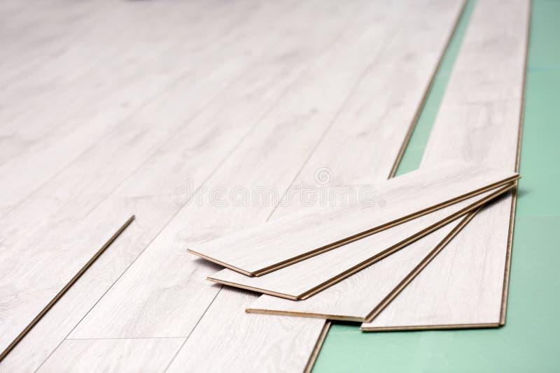 Installing laminate flooring. Decoration, clouseup stock photo