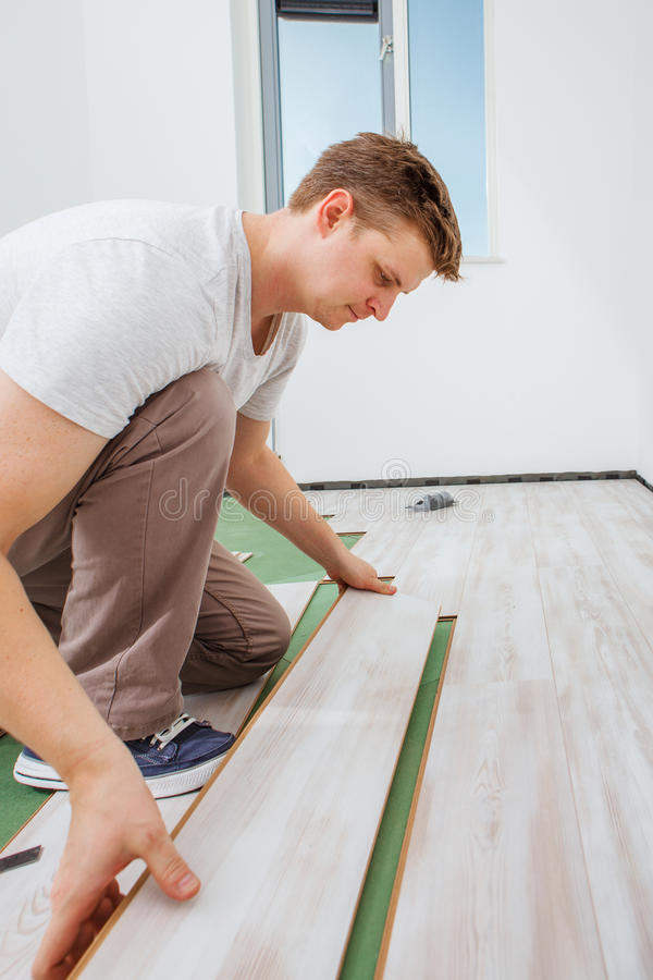 Installing laminate flooring royalty free stock photo