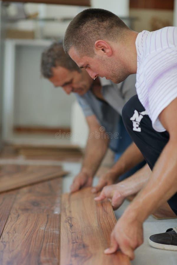 Installing laminate flooring stock image