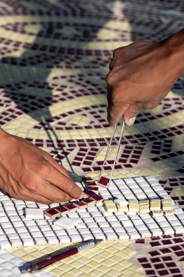 The installing mosaic ceramic tiles royalty free stock images