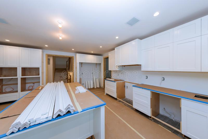 Installing new in modern kitchen of installation base for island in center. Installing new in modern kitchen cabinet of installation base for island in center stock images