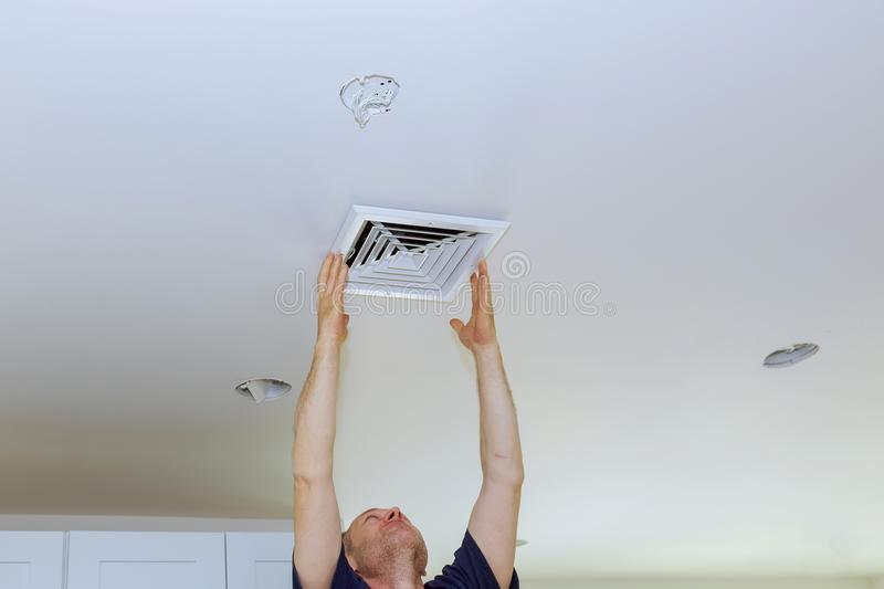 Ceiling Mounted Air Conditioner. New white air conditioning vent closeup stock photo
