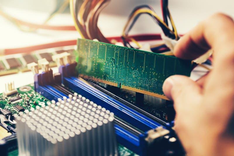 Installing ram memory module on desktop computer motherboard royalty free stock photos