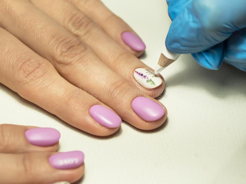 Installing rhinestones on nails. Close up. royalty free stock photos