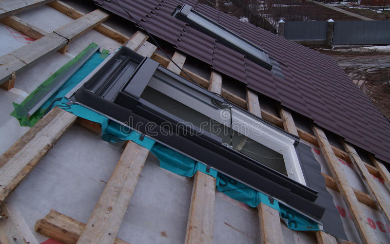 Installing roof skylights royalty free stock photo