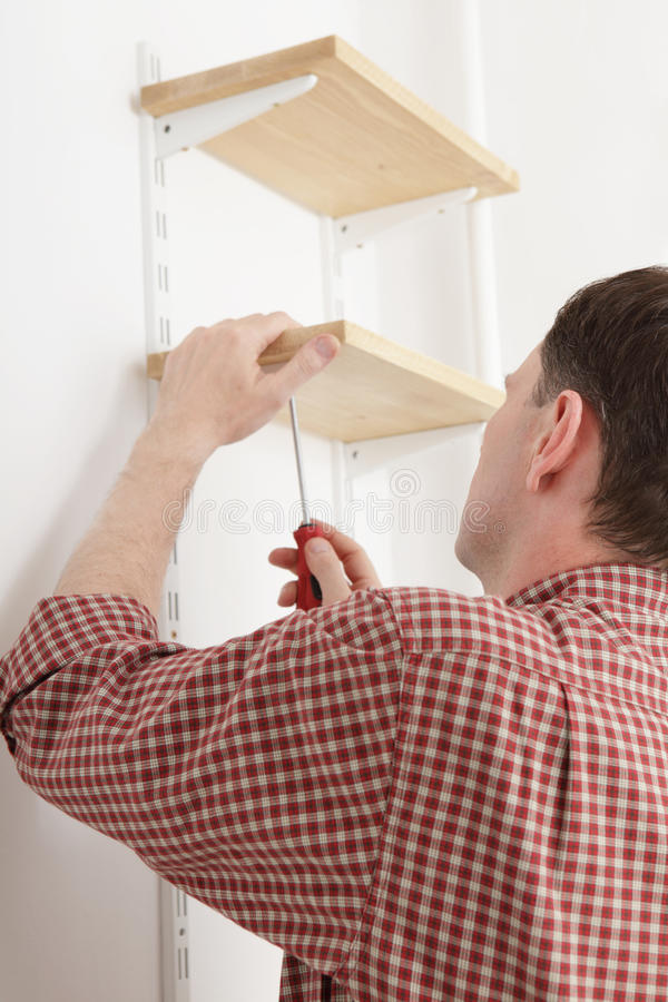 Installing shelves stock photography