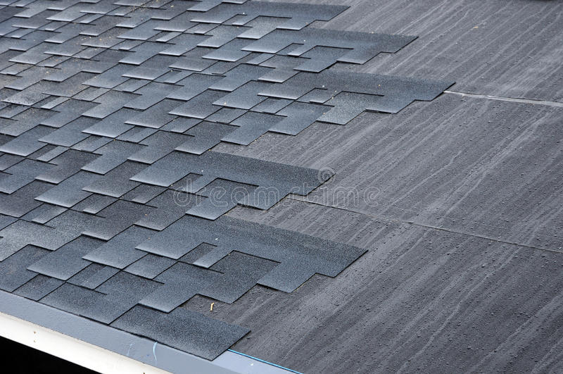 Installing Shingles. Installing Bitumen Roof Shingles. royalty free stock photography