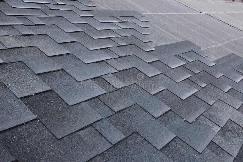 Installing Shingles. Installing Bitumen Roof Shingles. royalty free stock photo