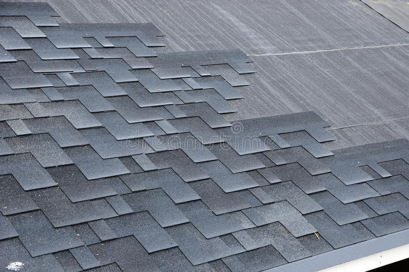 Installing Shingles. Installing Bitumen Roof Shingles. stock photography