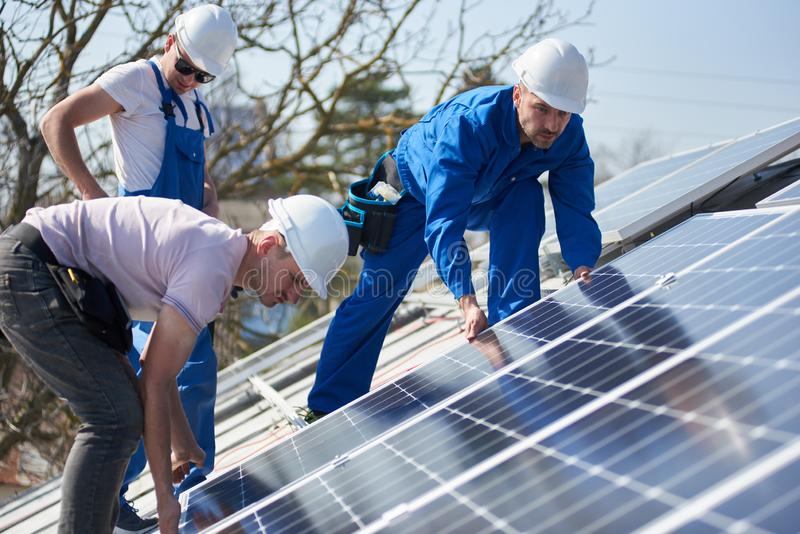 Installing solar photovoltaic panel system on roof of house royalty free stock photos