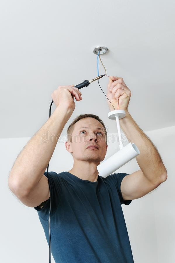 Installing a spotlight in the room. stock images