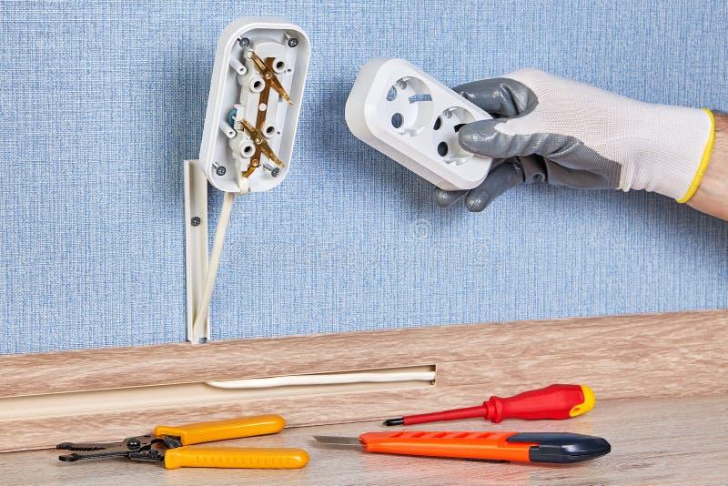 Installing of wall plug socket royalty free stock photography