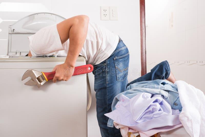 Installing washing machine royalty free stock image