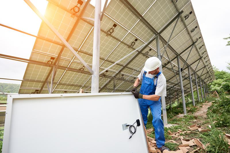 Installing of solar photo voltaic panel system royalty free stock photos