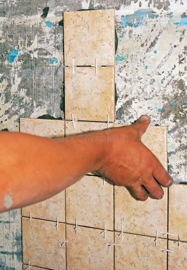 Installs ceramic  tiles